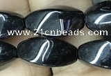 CAA2482 15.5 inches 6*12mm twisted rice black agate beads