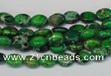 CDE178 15.5 inches 6*8mm oval dyed sea sediment jasper beads