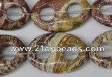 CFG309 15.5 inches 20*30mm carved oval dyed stripe jasper beads