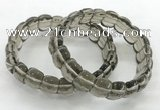 CGB3463 7.5 inches 10*14mm faceted oval smoky quartz bracelets