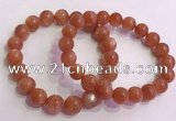 CGB4540 7.5 inches 10mm - 11mm round golden sunstone beaded bracelets