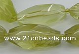 CNG5649 15.5 inches 15*35mm - 18*40mm faceted rice lemon quartz beads