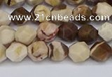 CNG6245 15.5 inches 6mm faceted nuggets zebra jasper beads