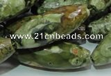 CPS72 15.5 inches 15*40mm faceted rice green peacock stone beads