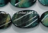 CTE1079 15.5 inches 22*30mm twisted oval dyed green tiger eye beads