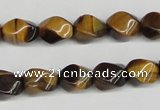 CTW151 15.5 inches 8*11mm twisted rice yellow tiger eye beads