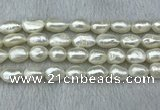 FWP285 15 inches 9mm - 10mm baroque white freshwater pearl strands